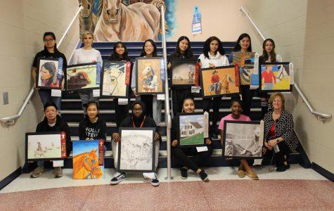 Art show winners pose with their teacher, Mrs. Bolt.